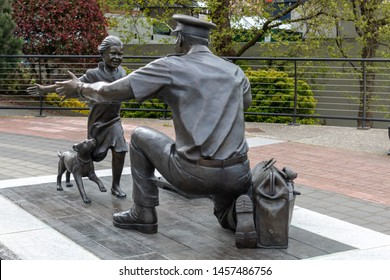"VICTORIA, CANADA - May 3, 2019: ""The Homecoming"" Statue, honouring Canadian Armed Forces in downtown Victoria, BC."