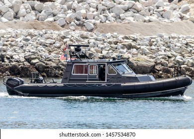 VICTORIA, CANADA - May 4, 2019: RCMP (Royal Canadian Mounted Police) patrol boat in Victoria, BC, downtown harbour.
