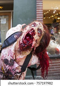 VICTORIA CANADA OCT 7 2017: People in costumes are on the Zombies walk in Victoria down town during the annual Zombie Walk .