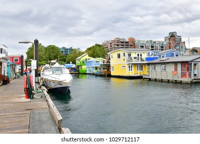 VICTORIA CANADA-OCT 6, 2017:Floating Home Village Houseboats Fisherman's Wharf Inner Harbor, Victoria British Columbia Canada.Area has floating homes, boats, piers, restaurants and adventure tours