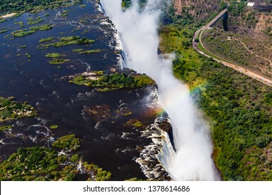 Victoria Falls from aerial view. Waterfall in southern Africa on the Zambezi River at the border between Zambia and Zimbabwe. Rainbow on the river.