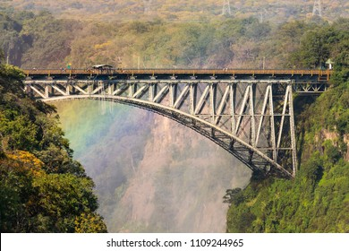 The Victoria Falls Bridge with a rainbow in the background