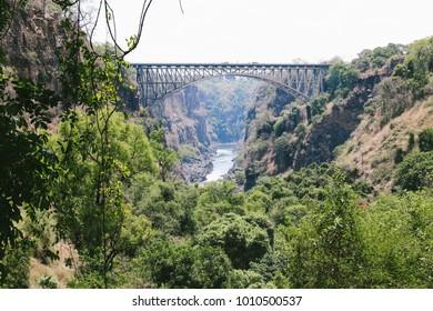 The Victoria Falls Bridge, which crosses the Zambezi River below the Victoria Falls and links two border towns of Victoria Falls, Zimbabwe and Livingstone, Zambia.