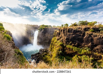 The Victoria falls is the largest curtain of water in the world (1708 meters wide). The falls and the surrounding area is the National Parks and World Heritage Site - Zambia, Zimbabwe