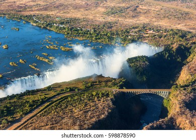 The Victoria falls is the largest curtain of water in the world (1708 m wide). The falls and the surrounding area is the National Parks and World Heritage Site (aerial view) - Zambia, Zimbabwe