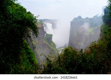 "Victoria falls, (Lozi: Mosi-oa-Tunya, ""The Smoke that Thunders"") is a waterfall in southern Africa on the Zambezi River at the border between Zambia and Zimbabwe"