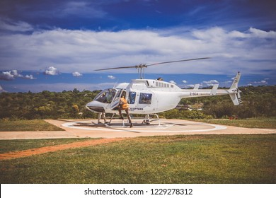 Victoria Falls,  Matabeleland North / Zimbabwe - 12.21.2017: the white helicopter against the background of the blue sky. Victoria Falls Helicopter Flights