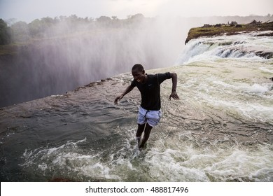 """Victoria Falls - Oct 13, 2012: The naturally formed """"Devil's Pool"""""""