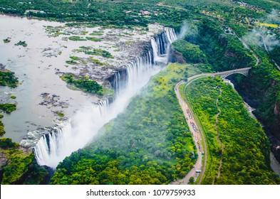 "Victoria Falls (Tokaleya Tonga: Mosi-oa-Tunya, ""The Smoke that Thunders"") is a waterfall in southern Africa on the Zambezi River at the border between Zambia and Zimbabwe."