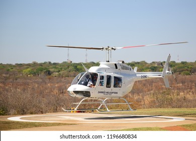VICTORIA FALLS, ZIMBABWE - OCTOBER 3, 2018: The Zambezi Helicopter Company Bell 206 Helicopter fly Victoria Falls scenic flights and charter flights to the tourism industry