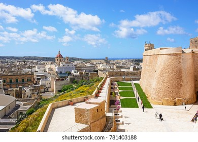 VICTORIA, GOZO, MALTA - APRIL 3, 2017 - Fortified buildings and the old moat within the citadel with views towards the city and Church, Victoria, Gozo, Malta, Europe, April 3, 2017.