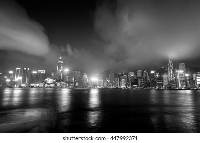 Victoria Harbor, Hong Kong - April 04, 2015 :Victoria Harbor view from Tsim Sha Tsui to Central District in Black and White tone - Shutterstock ID 447992371
