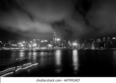 Victoria Harbor, Hong Kong - April 04, 2015 :Victoria Harbor view from Tsim Sha Tsui to Central District in Black and White tone - Shutterstock ID 447992407