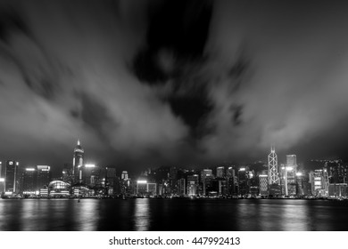 Victoria Harbor, Hong Kong - April 04, 2015 :Victoria Harbor view from Tsim Sha Tsui to Central District in Black and White tone - Shutterstock ID 447992413