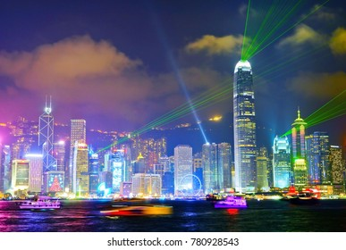 Victoria Harbor and Hong Kong skyline with the light show at night.