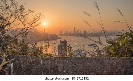 Victoria Harbour at evening during sunset, taken on Devil's Peak in Kowloon, Hong Kong