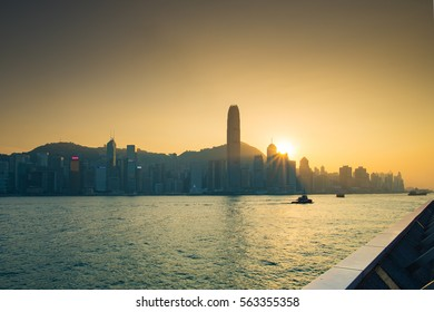 """VICTORIA HARBOUR, HONG KONG - DECEMBER 8, 2016: Sunset view at a famous tourist attraction """"Victoria Harbour"""" The Hong Kong riverside destination."""