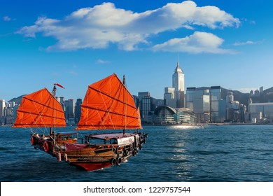 Victoria Harbour with junk ship in Hong Kong.