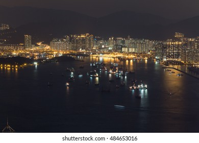 Victoria harbour and Stonecutters island at night