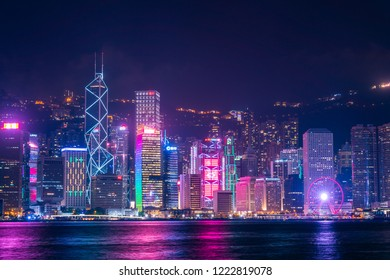 Victoria Harbour,Hongkong,China,october 2018. A group of skyscrapers in Hongkong and Kowloon from Victoria harbour viewpoint during night. Place for tourism spot. Beautiful skyline and nice panoramic