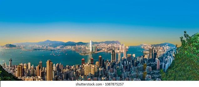 VICTORIA, HONGKONG - JAN 9, 2010: Hong Kong view from Victoria Peak to the bay and the skyscraper in sunset in Victoria, Hongkong.
