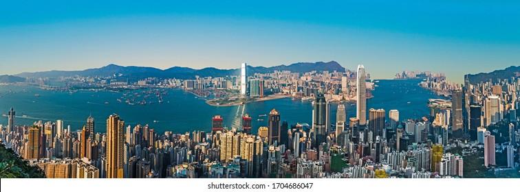 Victoria, Hongkong - January 9, 2010: Hong Kong view from Victoria Peak to the bay and the skyscraper ins sunset, Victoria, Hongkong.
