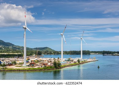 Victoria, Mahe island, Seychelles - December 17, 2015: Wind turbines producing clean electricity in Victoria harbor, Mahe Island, Seychelles, Indian Ocean, East Africa.