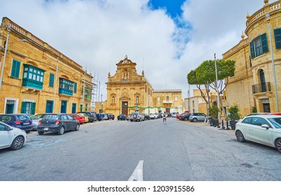 VICTORIA, MALTA - JUNE 15, 2018: The scenic St Francis Church, located in same named square and surrounded by historical edifices, on June 15 in Victoria.