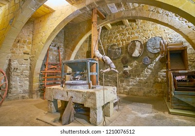 VICTORIA, MALTA - JUNE 15, 2018: Interior of the Folklore Museum (Gran Castello Historic House) with millstones, medieval sieves on walls and other pieces for flour producing, on June 15 in Victoria.