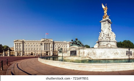 Victoria Memorial and Buckingham Palace London, home to the Queen of England. Clear deep blue summer sky.