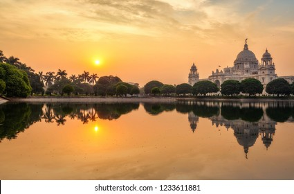 Victoria Memorial colonial architecture structure with lake at sunrise at Kolkata India.