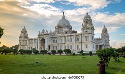 Victoria Memorial at  sunrise with moody sky. A historical white marble monument and museum built in the memory of Queen Victoria at Kolkata, India.