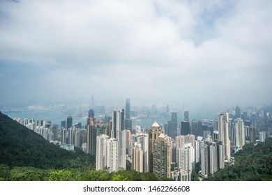Victoria Peak, Hong Kong - Oct' 24th 2018 A cloudy day at the Victoria Peak in Hong Kong , this stunning viewpoint will blow your mind with its iconic skyscrapers and the harbor below.