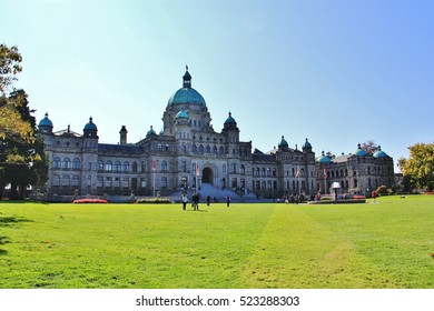 Victoria Provincial Parliament Building with flowers at harbor in province of British Columbia Canada