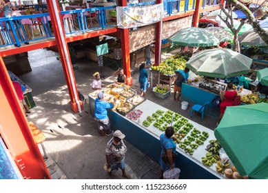 VICTORIA, SEYCHELLES – AUGUST 03 2018: Several locals shopping for fresh fruit in Victoria, Seychelles