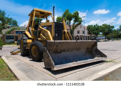 VICTORIA, TEXAS - JUNE 7 2018: a Caterpillar 416 series loader backhoe idle in the parking lot