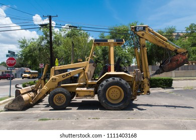 VICTORIA, TEXAS - JUNE 7 2018: seen in profile the Caterpillar 416 loader backhoe is a common sight