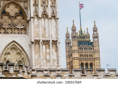 The Victoria Tower of the Houses of Parliament, London, UK, seen behind Westminster Abbey