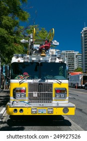 VICTORIA, VANCOUVER ISLAND, BC, CANADA - 15 July 2014: font view of yellow fire engine on the streets of Victoria