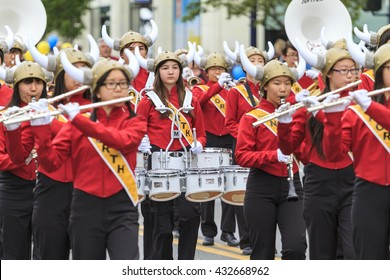 VICTORIA,BC,CANADA-MAY 23,2016: Marching Bans from Canada and USA in the Victoria Day parade along Douglas Street. This is Victoria's largest parade, attracting well over 100,000 people..