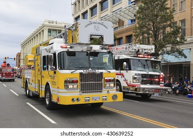 VICTORIA,BC,CANADA-MAY 23,2016: Old and new fire engines parading in the Victoria Day along Douglas Street. This is Victoria'??s largest parade, attracting well over 100,000 people.