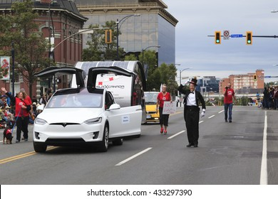 VICTORIA,BC,CANADA-MAY 23,2016: People, Organizations from Canada and USA in the Victoria Day parade along Douglas Street. This is Victoria's largest parade, attracting well over 100,000 people..