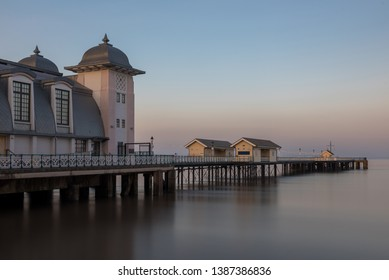 The victorian architecture of Penarth Pier, near Cardiff on the coast of south Wales. The sea is smooth due to a long shutter speed.