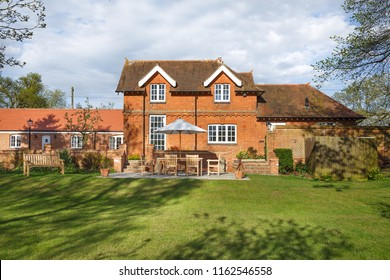 Victorian coach house and stables with garden and patio. The historic building has been converted into a modern family home