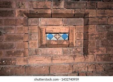 Victorian decorative  red brick tiled motif inlay.