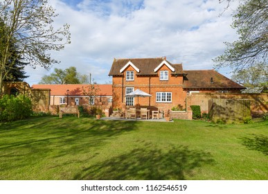 Victorian former coach house and stables with garden and patio. The historic building has been converted into a modern family home