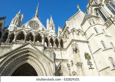 The Victorian Gothic style main entrance to the The Royal Courts of Justice public building in London, UK, opened in 1882