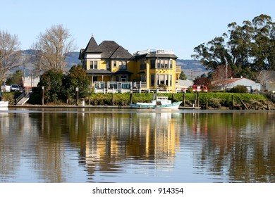 Victorian house on river's edge