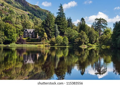 Victorian houses at the lakeside the of Loch Ard, Trossachs National Park, Stirling District, Scotland, United Kingdom