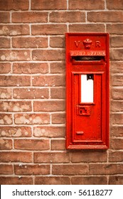 victorian mail box abstract against a brick wall with blank white space for copy